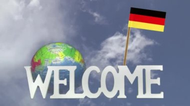 Turning globe and small paper flag of  GERMANY — Stock Video