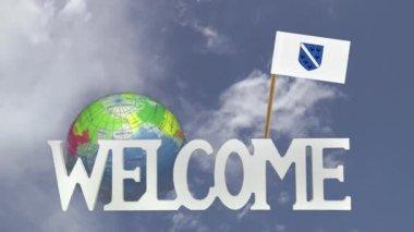 Turning globe and small paper flag of  BOSNIA HERZOGOVINIA — Stock Video
