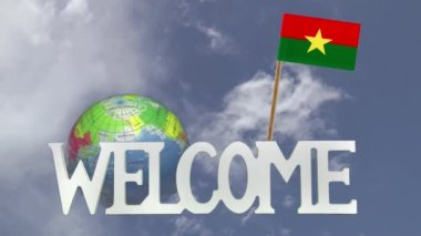 Turning globe and small paper flag of BURKINA FASO — Stock Video
