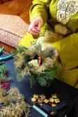 Woman making christmas wreath — Stock Photo