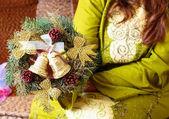 Woman hold christmas wreath — Stock Photo