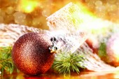 Golden christmas ball on abstract background — Stock Photo
