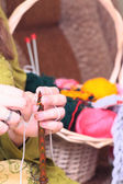Woman hands knitting — Stock Photo