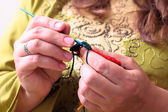 Close-up of hands knitting — Stock Photo