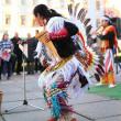 CHERNOVTSY, UKRAINE, October 22, 2010: Peruvian street musician singing and dancing — Stock Photo #71459053