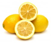 Sliced lemons isolated on white — Stok fotoğraf