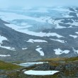 Summer mountain with lake and snow (Norway) — Stock Photo #55191735