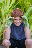 Young boy with green gloves — Stockfoto