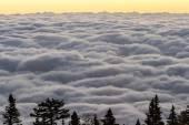 Východ slunce nad mraky — Stock fotografie
