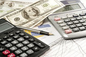 Fountain pen and calculator on the financial graph — Stock Photo