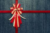 Red Ribbon on  detailed scan of jeans for background — Zdjęcie stockowe