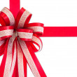 Red gift ribbon and bow, isolated on white background. — Stock Photo #59749303