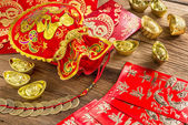 Chinese new year decoration,Chinese red bag and golden bullion — Stock Photo