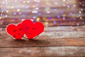Two Red Valentine hearts smily and hug  — Stock Photo