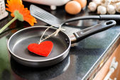 Eggs in a frying pan for Love — Stock Photo