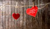 Red hearts with clothespin hanging on clothesline — Stock Photo