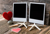 Two photo frames and valentines day  heart over wooden backgroun — Stock Photo