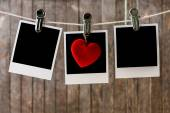 Three blank instant photos hanging on the clothesline — Stock Photo