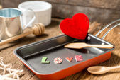The word love in frying pan for Love or Heart Healthy — Stock Photo