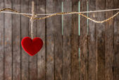 Red heart with clothespin hanging on clothesline  — Foto de Stock