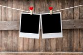 Two Old picture frame hanging on the clothesline — Stock Photo