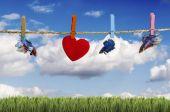 Green field under blue sky with hearts shape — Foto de Stock