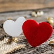 Red Valentines  hearts on old rustic wooden background — Stock Photo #64443247