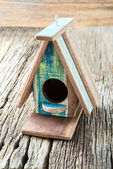 Bird House on wooden background — Stock Photo