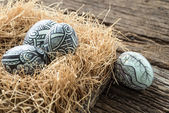Nest with Easter eggs on the wooden background — Stock Photo