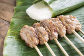 Roasted pork with white sticky rice Banana leaves on wooden tabl — Stock Photo