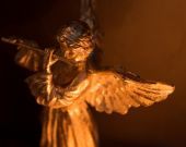 Winged Angel Playing Flute — Stock Photo
