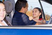Dad Hugs Daughter At Car — Stock Photo