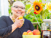 Woman Snacks On Fresh Fruit — Stock Photo