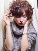 Cute Female Fussing With Hair — Stock Photo