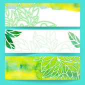 Banners with green watercolor leaves — Stock Vector