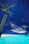 Hammock in the middle of tropical lagoon — Stock Photo