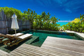 Private swimming pool on beach — Stock Photo