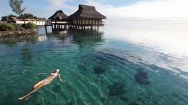 Woman swimming in a coral lagoon — Vidéo