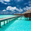Overwater villas on the tropical lagoon with jetty — Stock Photo #72743549