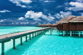 Overwater villas on the tropical lagoon with jetty — Stock Photo