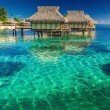 Villas in the lagoon into shallow water with coral — Stock Photo #78984684