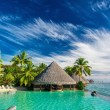 Infinity pool with artificial beach — Stock Photo #78984810