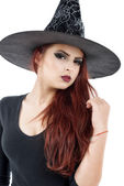 Pretty young redhead witch, isolated against white background — Stock Photo