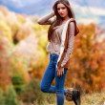 Young brunette woman portrait in autumn color — Stock Photo #56136527
