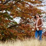 Young brunette woman portrait in autumn color — Stock Photo #56136569
