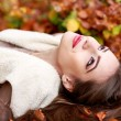 Young brunette woman portrait in autumn color — Stock Photo #56136623