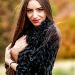 Young brunette woman portrait in autumn color — Stock Photo #56136697