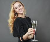 Beautiful elegant woman with a glass of champagne in hand isolat — Stock Photo