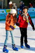A girl and a boy friend on the rink — Stock Photo