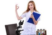 Beautiful woman showing sign ok laboratory science — Photo